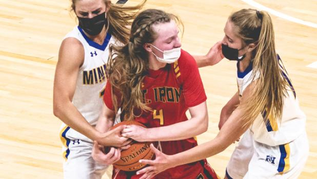 Minneota's Abby Hennen, left, and Natalee Rolbiecki, right, apply defensive pressure on Mt. Iron-Buhl's Jordan Zubich (4) during their semifinal win Tuesday at Target Center.