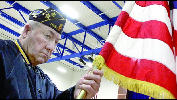Harold DeSmet presented the American Flag.