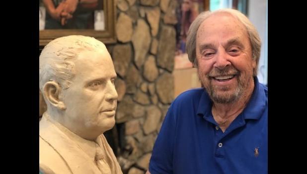 Don Haugen works on a bust in his studio in Marietta, GA.