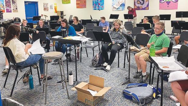 Several cast members of the Minneota High School fall musical had a read-through recently with director Aubree Cheadle, left.