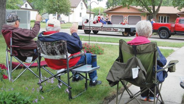Minneota community members wave as the Boxelder Bug Days parade passed by on Jefferson Street on Saturday.