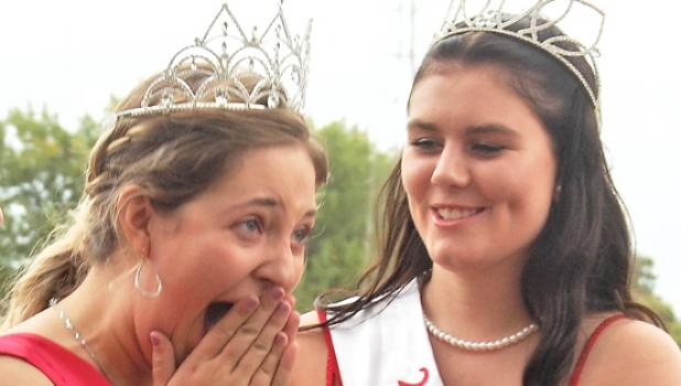 Brooke Moorse (left) showed her emotion as she was crowned Boxelder Bug Days Queen by retiring Queen Jodi Buysse (right).