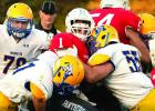 Jacob Citterman (left) and Beau Banish collared TMB quarterback Sawyer Otto. In the back was Jackson Esping.