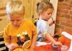 Royce Pochardt, 4, and Regan Pochardt, 2, painted pumpkins.