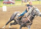 Josey Fey, riding her horse O SO Country, makes a turn during the Silver Spurs Barrel Race competition last Wednesday at the arena on the north side of Minneota.