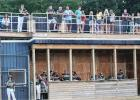 Fans watched the Mudhens' game last week during Fan Appreciation Night from the walkway above the dugout.