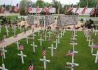 """Veterans Park in Minneota was a sea of red, white and blue with American flags on each of the 286 white crosses that represented deceased veterans from the area, and 34 gold crosses representing area soldiers who were killed in action. Despite the COVID-19 pandemic keeping a few people away, the Memorial Day """"Light a Light"""" ceremony was well attended on a mild evening."""