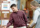 Evan Hennen had the attention of judge Alexis Streich as he explained his project about shining pennies and the conclusions he came to during his preparation.